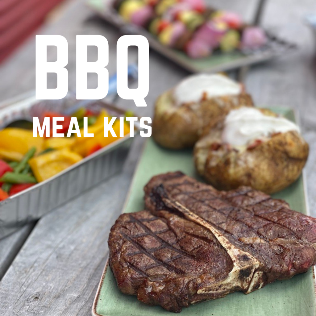 Porterhouse steak with baked potatoes and text overlay that reads: BBQ Meal Kits